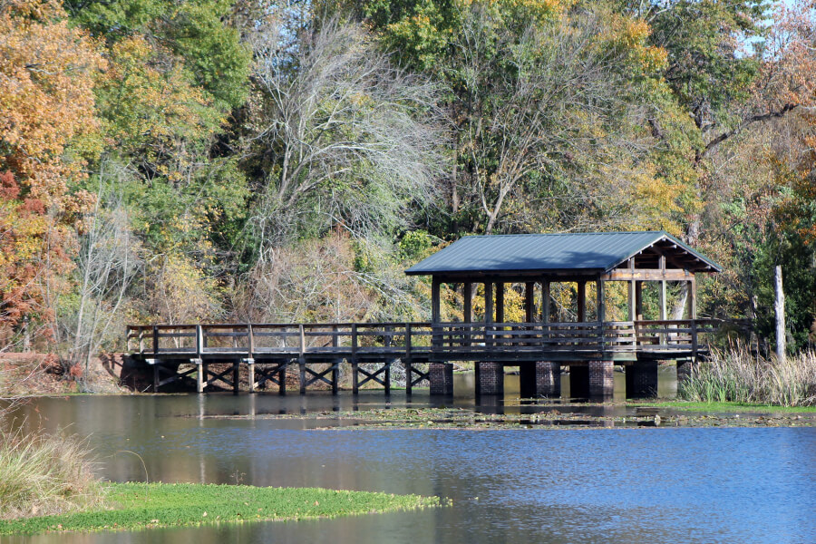 North Augusta - Wooden Bridge with Roof ontop of Blue River